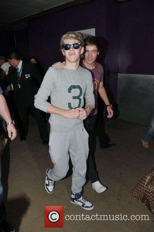 Niall Horan, Liam Payne One Direction arrive at...