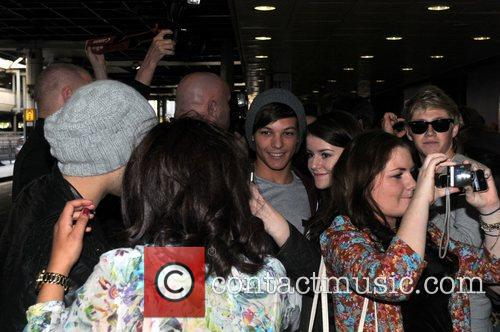 Niall Horan, Louis Tomlinson One Direction arrive at...