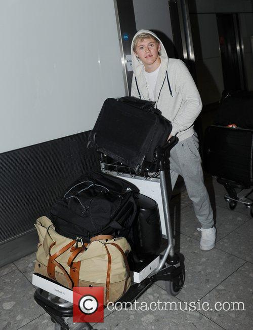 Niall Horan of One Direction arriving at Heathrow...