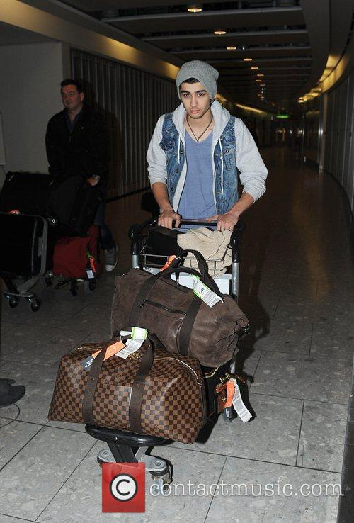 Zayn Malik of One Direction arriving at Heathrow...