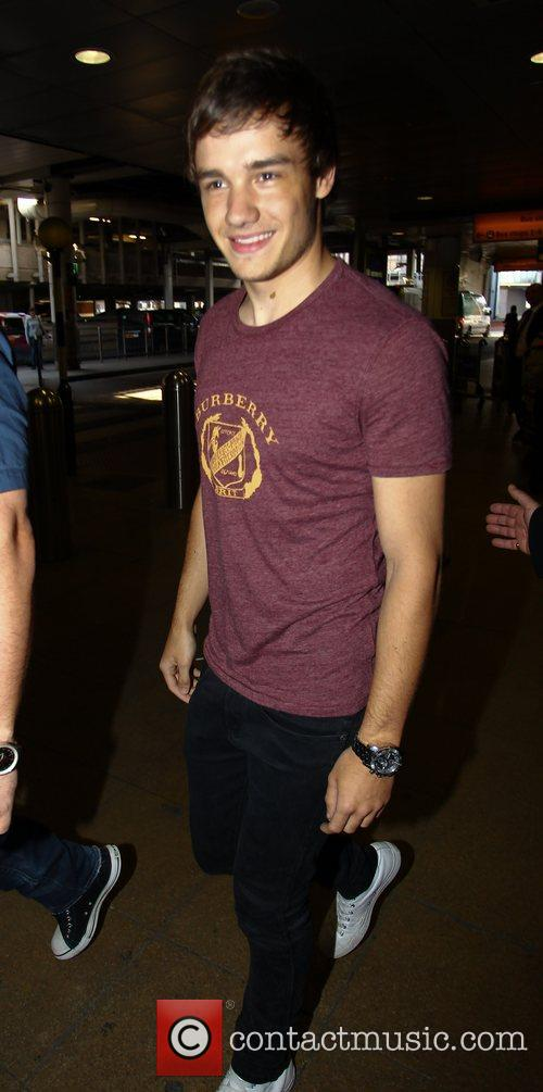 Liam Payne One Direction arrive at Heathrow airport...