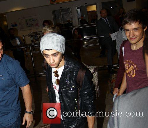 Zayn Malik, Liam Payne One Direction arrive at...