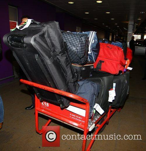Luggage One Direction arrive at Heathrow airport London,...