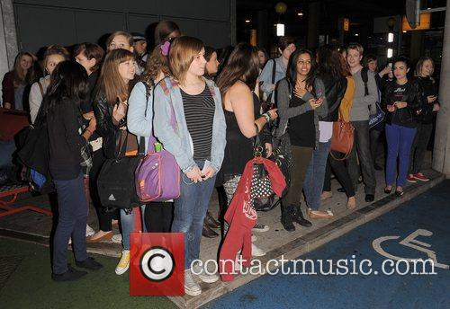 One Direction fans One Direction, arrive back home...