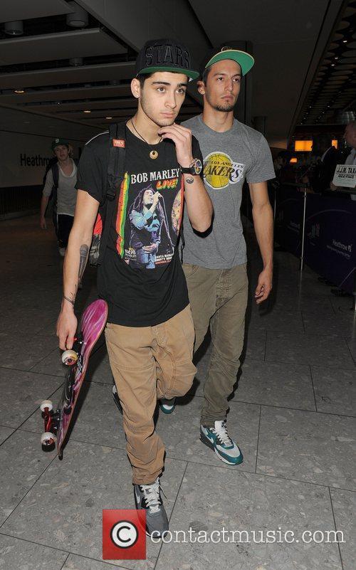 Zayn Malik from boyband One Direction, arrives back...