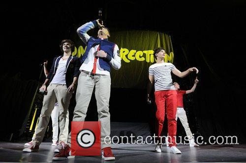 One Direction performs on stage at The Air...