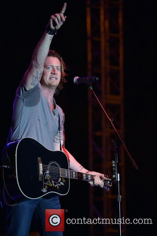 Tyler Hubbard 2013 Discover Orange Bowl between the...