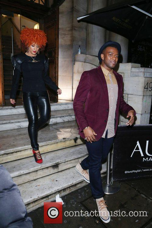 Leaving Aura nightclub with a red haired women.