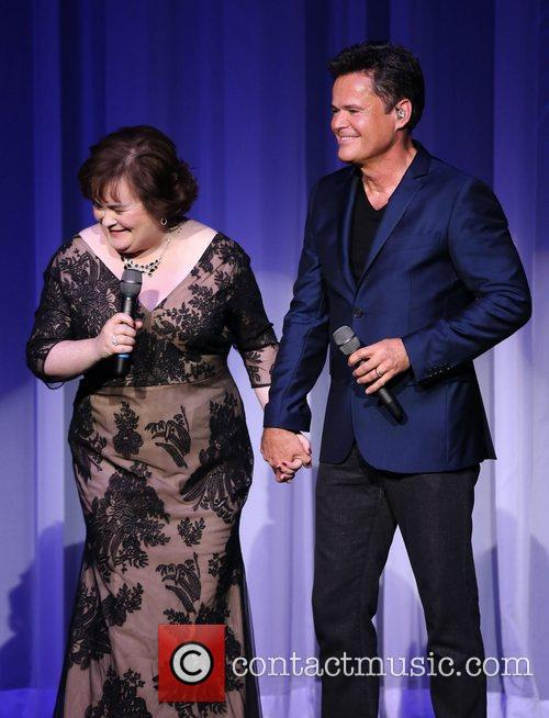 Susan Boyle performs with Donny Osmond during the...