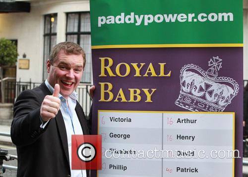 A representative from bookmakers Paddy Power displays odds...