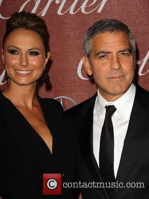 Stacy Keibler and George Clooney The 23rd annual...