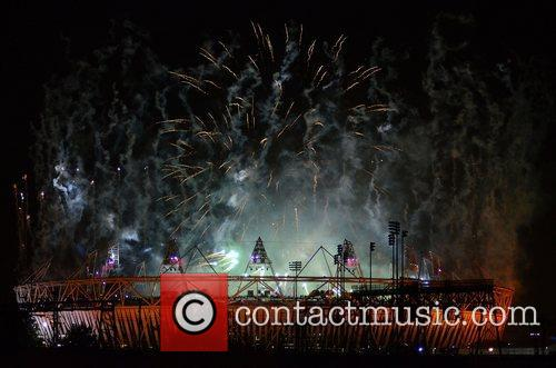 Fireworks explode over the stadium during the opening...