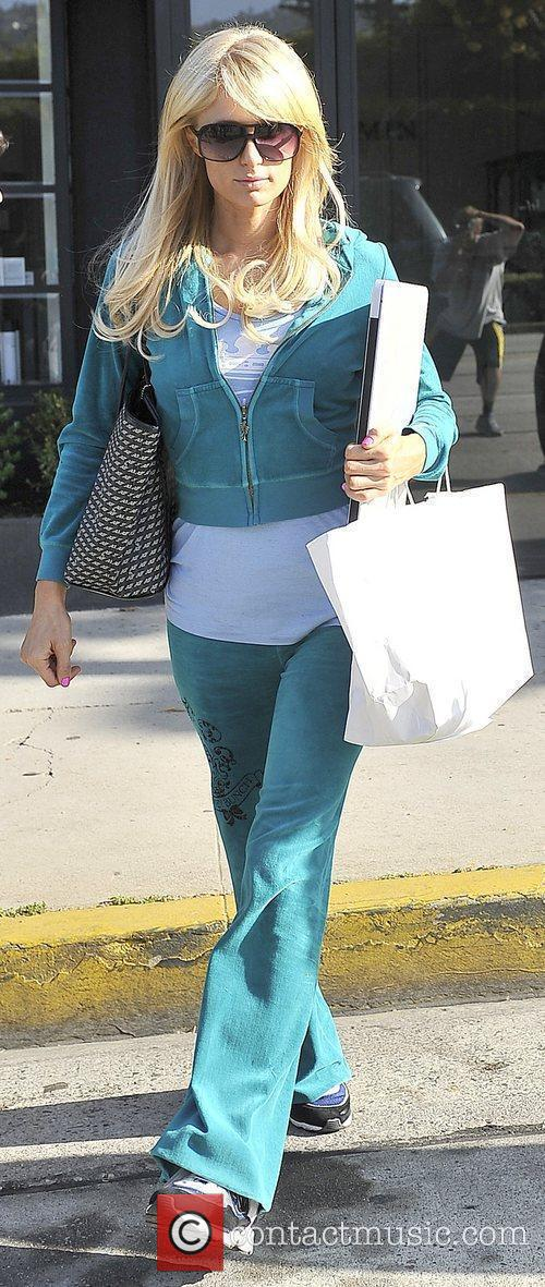 Leaving a hair salon wearing a turquoise tracksuit