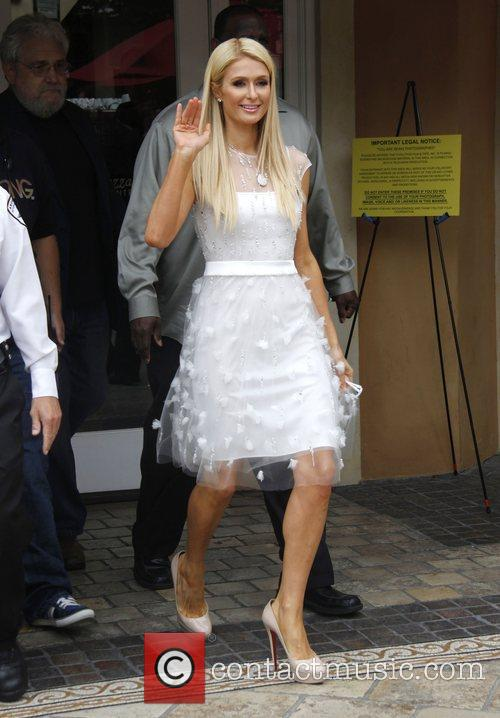 Paris Hilton at The Grove helping launch her...