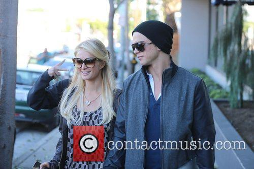 Paris Hilton and boyfriend River Viiperi hold hands...