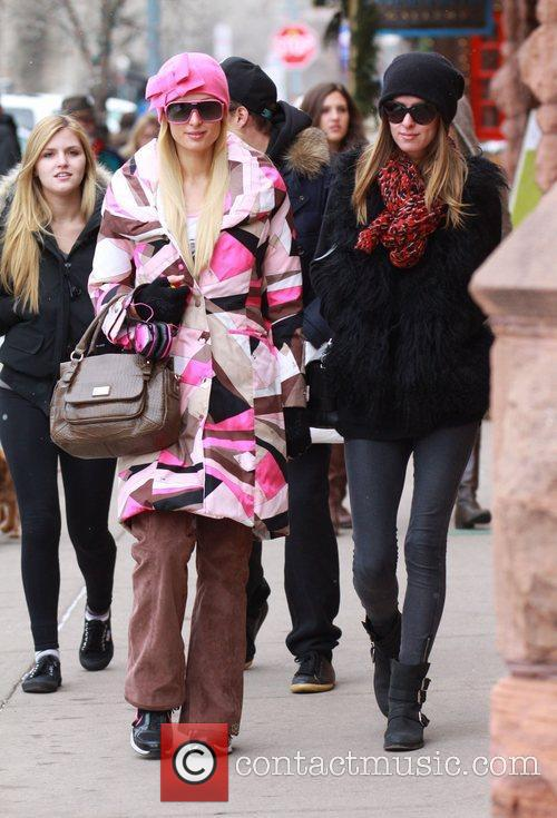 Paris Hilton and Nicky Hilton dressed in winter...