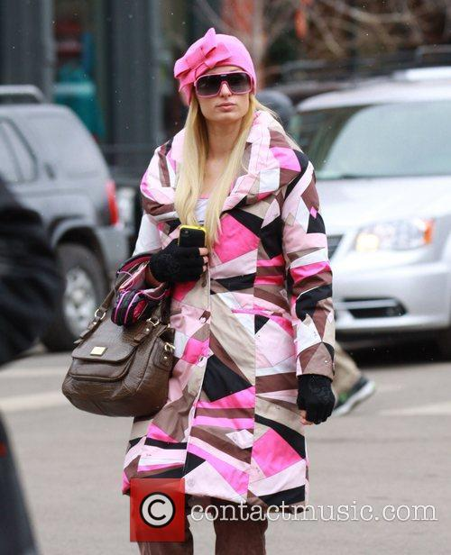 Paris Hilton dressed in winter clothes as they...