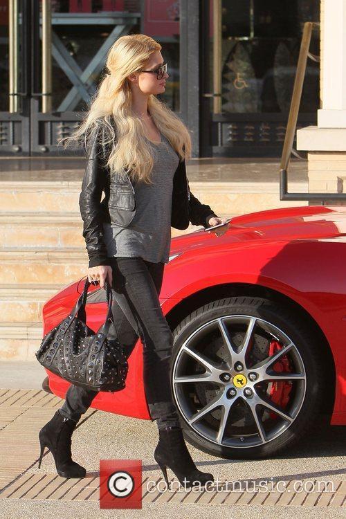 Paris Hilton returns to her Rosso Ferrari California...