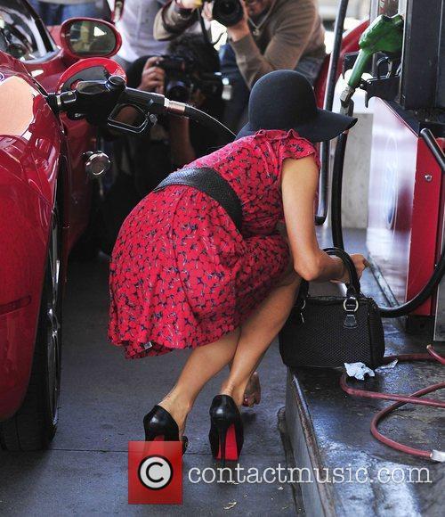 Paris Hilton in a colour co-ordinated red dress...