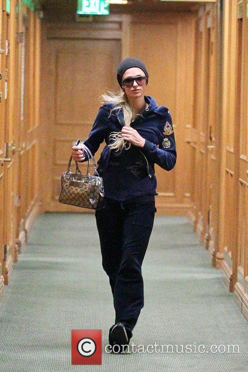Paris Hilton dressing down in sweatpants, leaving a...