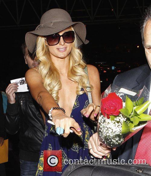 Paris Hilton arrives at LAX airport for a...