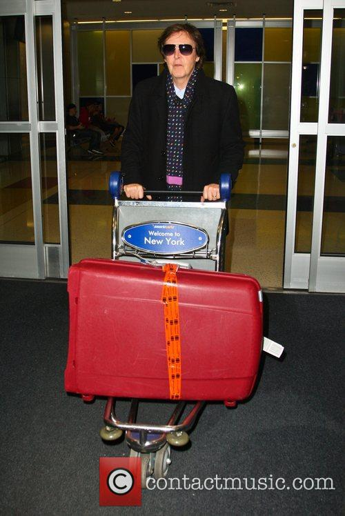Pushes his own luggage after arriving on a...