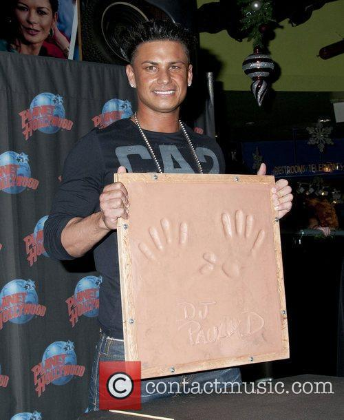 Takes part in a handprint ceremony at Planet...