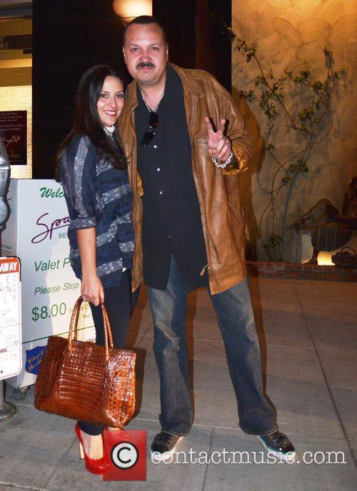 Leaves Spago restaurant in Beverly Hills after having...