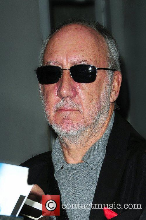 The Who's Pete Townshend signs autographs outside...