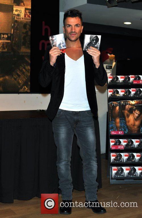 Peter Andre signs copies of his new album...