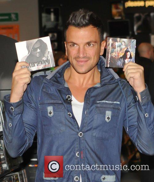 Signs copies of his new album 'Angels and...