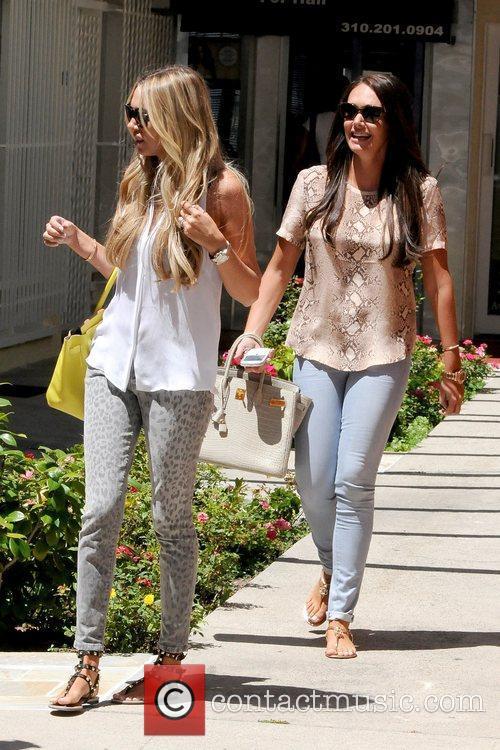 Petra Ecclestone and Tamara Ecclestone British socialites shopping...