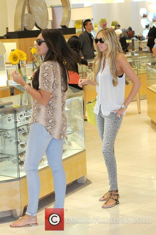 Tamara Ecclestone and Petra Ecclestone British socialites shopping...