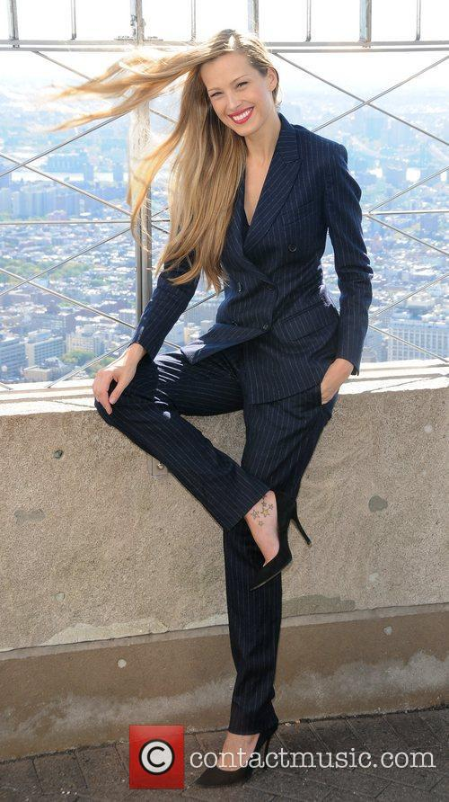 Petra Nemcova lights the Empire State Building blue...
