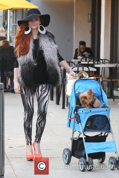 Phoebe Price and her dog Henry strolling in...