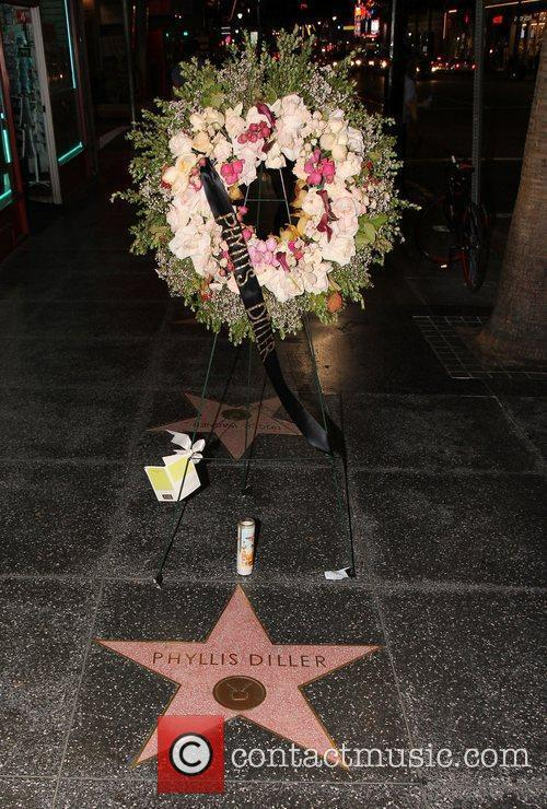 Flowers are placed on the Hollywood Walk of...