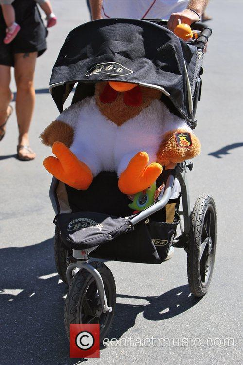The stroller of Pink's daughter, with a stuffed...