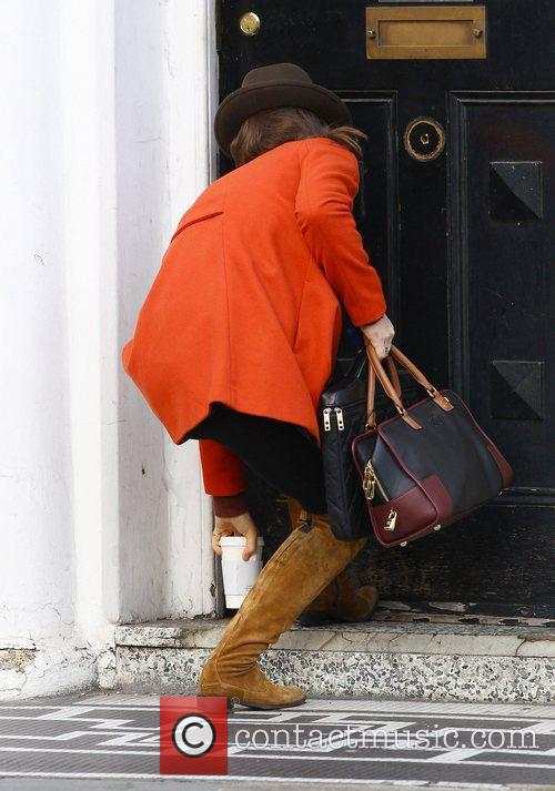 Pippa Middleton arrives for her first day back...