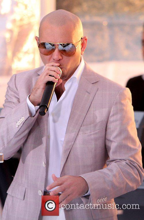 Pitbull performing live at the Rockefeller Center as...