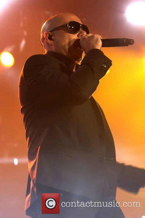 Pitbull performing on stage at the Ricoh Coliseum