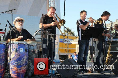 Poncho Sanchez performs on the beach in Hermosa...