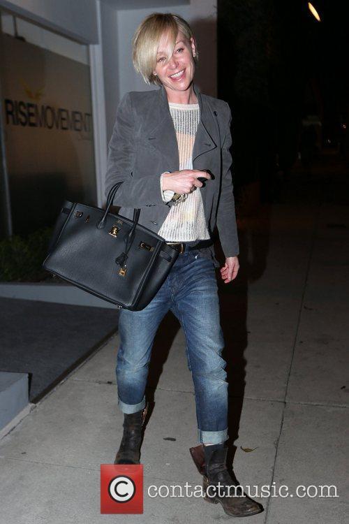 Portia de Rossi  walks back to her...