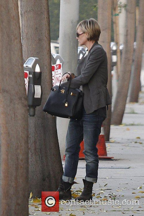 Portia de Rossi  pays for her parking...