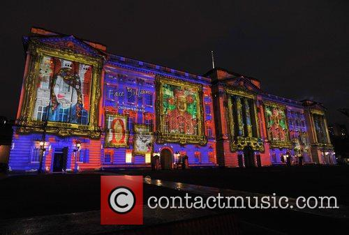 Over 200,000 children's portraits are projected on to...