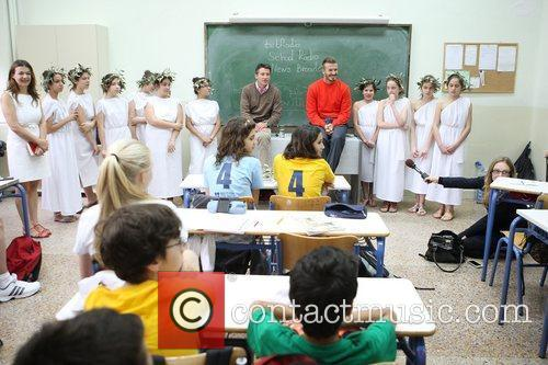 Meets local schoolchildren during a visit to The...