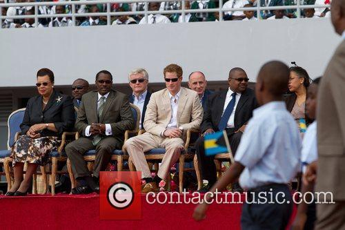 Prince Harry sits with dignitaries at a Youth...