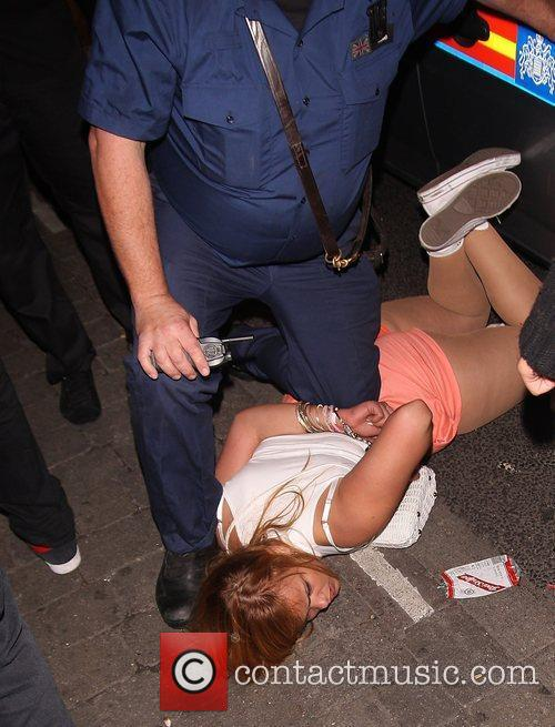 A woman is arrested Puma party held at...