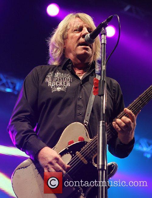 Rick Parfitt of Staus Quo performing on stage...