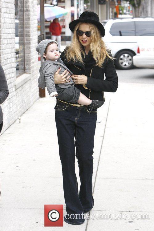 Rachel Zoe holding her son, Skylar in her...