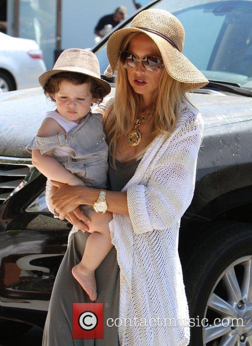 Carries her son Skyler Berman whilst she shops...